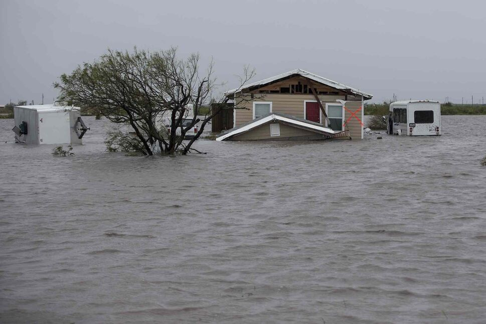A ranch home sits submerged near Railroad Avenue in Taft, Texas, on Saturday, Aug. 26, 2017. (Robert Gauthier / Los Angeles Times)