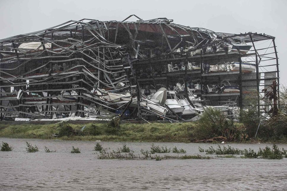 A large boat storage facility teeters on the brink of collapse after being ripped apart by Hurricane Harvey in Rockport, Texas, on Saturday, Aug. 26, 2017.  (Robert Gauthier / Los Angeles Times)