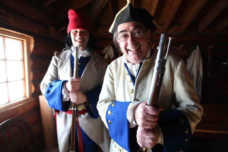 Historical re-enactors William Caithness, left, and Marc Charbonneau enjoy volunteering at Festival du Voyageur on Saturday.   (Ruth Bonneville / Winnipeg Free Press)