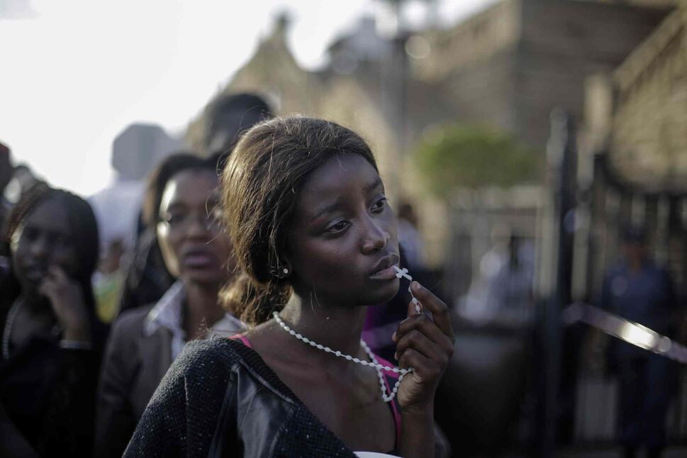 First prize in the People Observed Portraits Single category by Markus Schreiber of Germany<p> A woman reacts in disappointment after access to see former South Africa President Nelson Mandela was closed on the third and final day of his casket lying in state outside Union Buildings in Pretoria, South Africa on Dec.13, 2013.  (Markus Schreiber / The Associated Press)