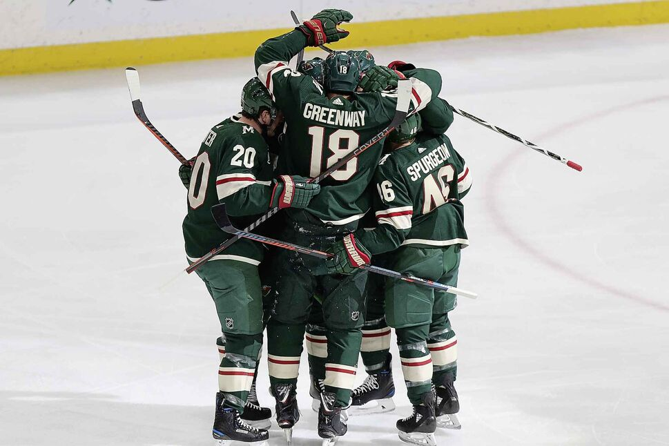Minnesota Wild players celebrate after scoring against the Winnipeg Jets in their 3-2 win Thursday.