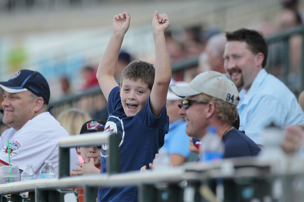 A young spectator gets excited during the All-Star Skills Competition at Shaw Park Monday. (John Woods / Winnipeg Free Press)