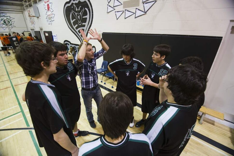 Coach Tim Brock instructs the team before the game. (DAVID LIPNOWSKI/WINNIPEG FREE PRESS)