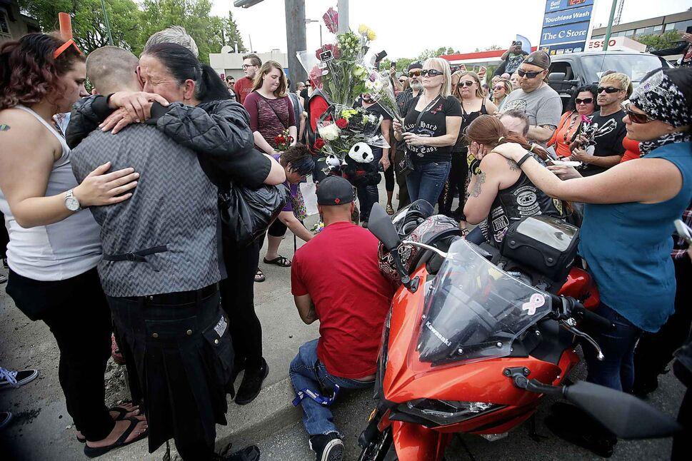 JOHN WOODS / WINNIPEG FREE PRESS</p><p>Friends and supporters gathered at the corner of Portage Avenue and Home Street Tuesday, June 5, 2018 to remember Matt Cave who was killed in a motorcycle collision with a stolen van.</p>