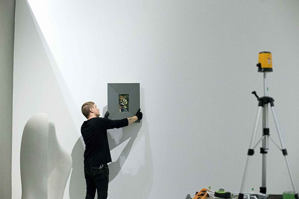 MIKAELA MACKENZIE / WINNIPEG FREE PRESS</p><p>Preparator Serge Saurette hangs pieces at the Winnipeg Art Gallery for the new summer exhibition, Summer with the Impressionists, in Winnipeg Tuesday, June 5, 2018.</p>