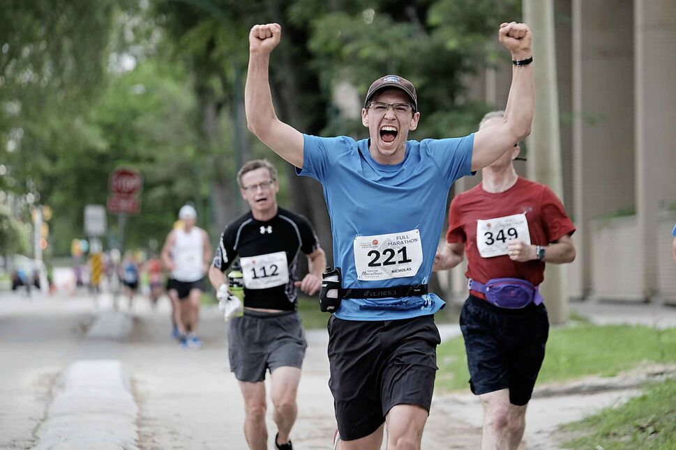 DANIEL CRUMP / WINNIPEG FREE PRESS</p><p>Nicholas Pasieczka, 17, pumps his hands in the air during 40th Manitoba Marathon, Sunday, June 17, 2018. The marathon marked a major milestone in his life — he went on to finish first in the youth male category in the full marathon.</p>