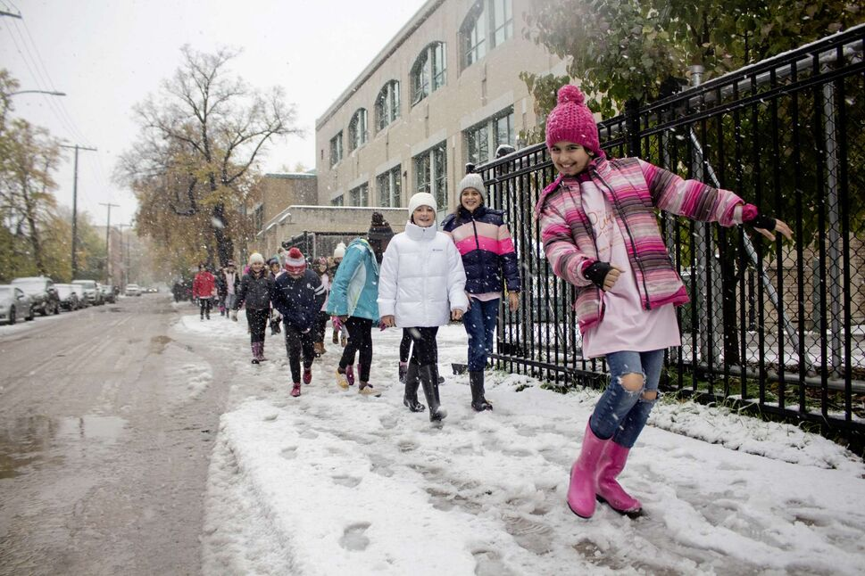 Sleet and snow did not stop the students at Balmoral Hall School from walking around campus in support of breast cancer research. Students and faculty raised money for the CancerCare Manitoba Foundation, presenting a cheque for $17,050 to the foundation on Oct. 10. The school has raised more than $410,000 towards breast cancer research since 2001. (Photos by Justin Luschinski)