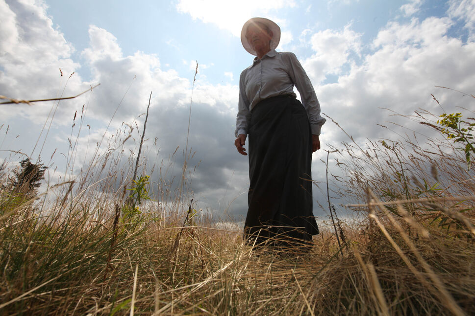 Oriole Vane Veldhuis, author of For Elise: Unveiling The Forgotten Woman On The Criddle Homestead, walks in the tall prairie grass at her great-grandmother Else Vane's homestead.   (Ruth Bonneville / Winnipeg Free Press  )