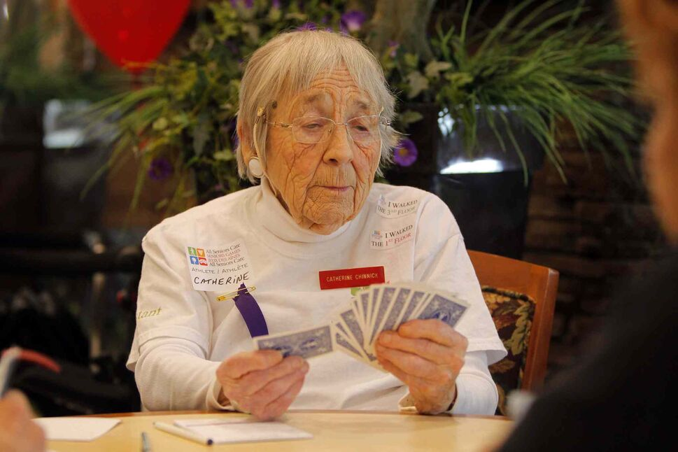 Catherine Chinnick contemplates a play during the All Senior Care Senior Games 2014.   (Boris Minkevich / Winnipeg Free Press)