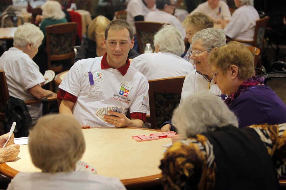 A young whipper-snapper joins in the fun at the All Senior Care Senior Games 2014.  (Boris Minkevich / Winnipeg Free Press)