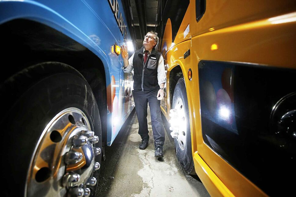 Hamelin continues inspecting his bus.</p>