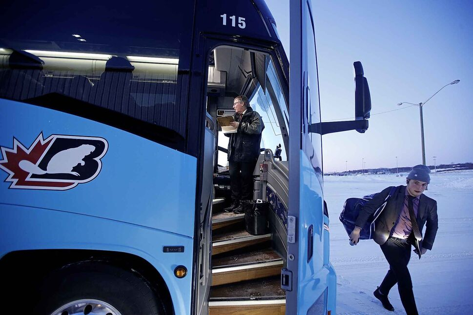 Hamelin updates his logbook on his bus as players head into the arena at Waywayseecappo.</p>