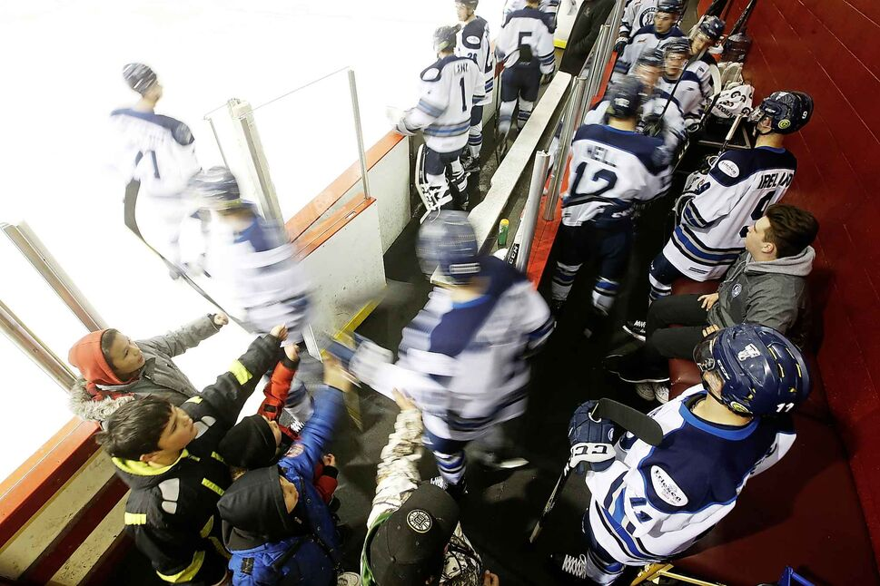 """Young fans """"high five"""" the Pistons as they hit the ice for second-period action.</p>"""