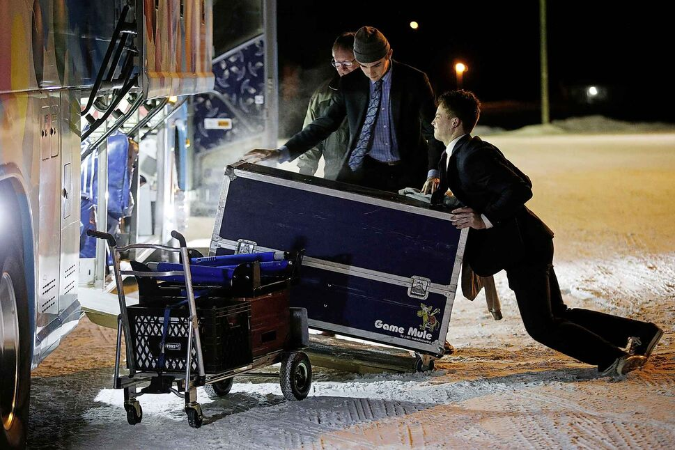Pistons load their gear onto the bus after their game.</p>