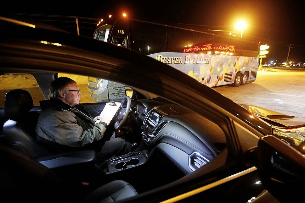 """Hamelin sits in """"relief vehicle"""" in a Portage La Prairie shopping mall after his relief driver, Gary Kansky, takes over the drive to the depot.</p>"""