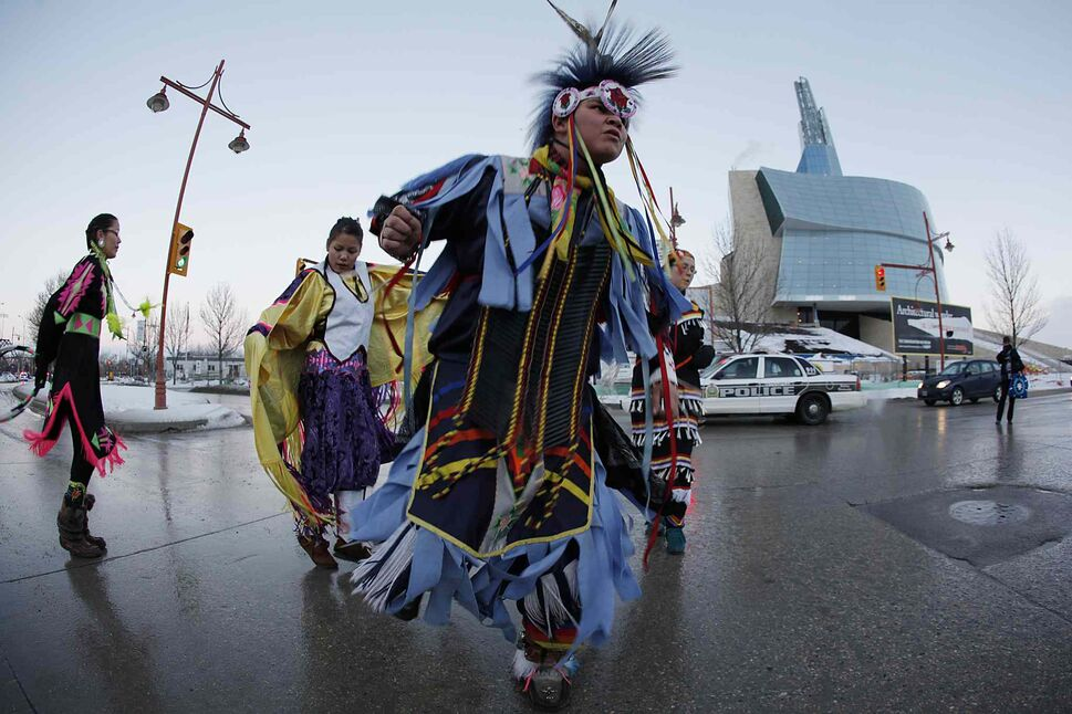 About 50 Idle No More protestors close the intersection of York and Waterfront Drive in front of the Canadian Museum for Human Rights January 7, 2013.  (John Woods / Winnipeg Free Press)