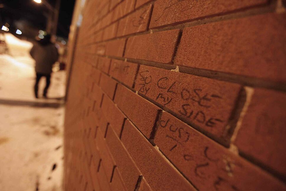 Graffiti on the wall of Main Street Project may give clients some comfort or distraction as they wait to enter the shelter. January 22, 2013.  (John Woods / Winnipeg Free Press)