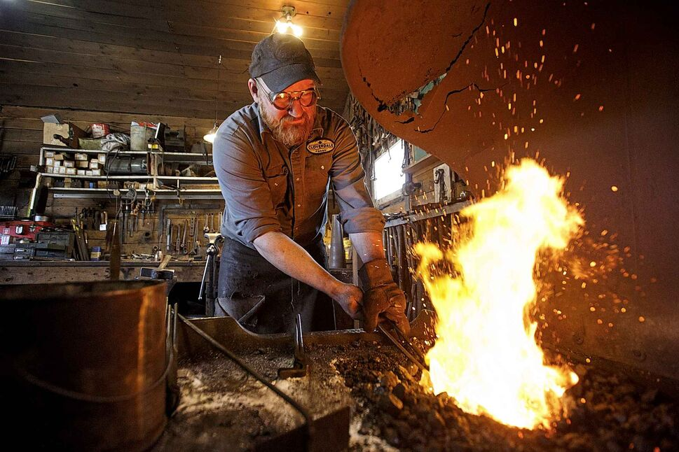 MIKE DEAL / WINNIPEG FREE PRESS</p><p>April 19 — Matt Jenkins, co-owner of Cloverdale Forge, works on an axe head that will be on display at the Manitoba Museum in the newly renovated Nonsuch gallery.</p>