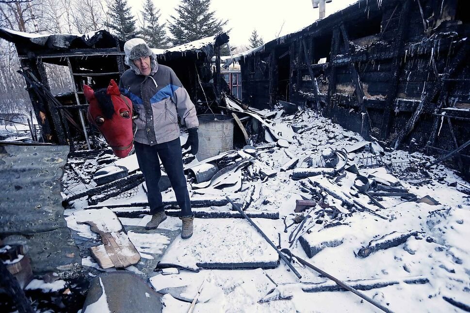 JOHN WOODS / WINNIPEG FREE PRESS</p><p>February 28 — Holding one of his favourite props, Al Simmons looks over the damage that resulted after a fire ripped through his prop trailers at his home in Anola, MB.</p>