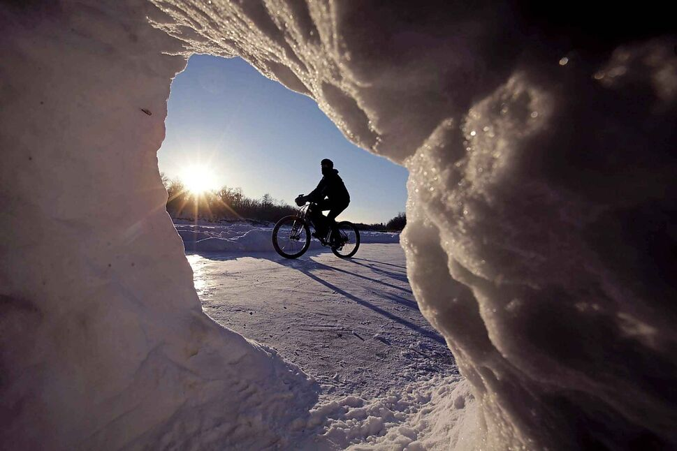 RUTH BONNEVILLE / WINNIPEG FREE PRESS</p><p>January 11 — Daniel Friesen goes for a leisurely afternoon bike ride along the Assiniboine River on his fat bike as long shadows streak across the river.</p>