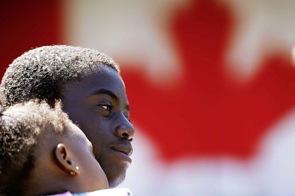 JOHN WOODS / WINNIPEG FREE PRESS</p><p>July 1 — Valentine Adedeji holds his young sister Debra prior to his citizenship ceremony on Canada Day at Assiniboine Park.</p>