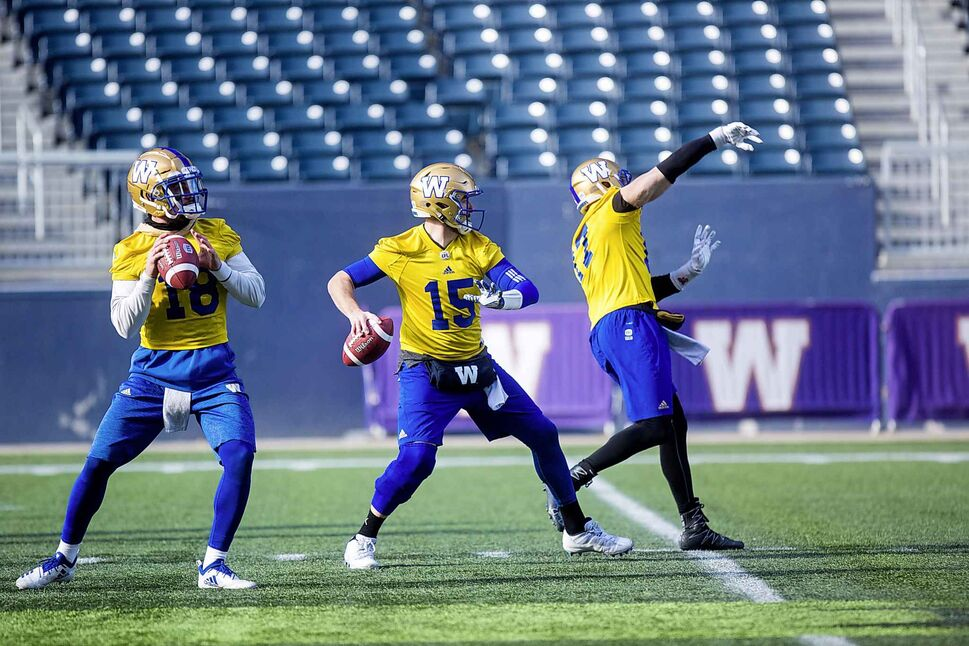 MIKAELA MACKENZIE / WINNIPEG FREE PRESS</p><p>October 22 — Quarterbacks Bryan Bennett (left), Matt Nichols, and Chris Streveler at Bombers practice at Investors Group Field.</p>