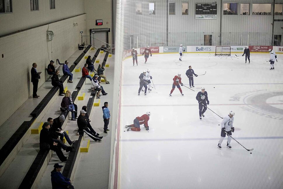 MIKE DEAL / WINNIPEG FREE PRESS</p><p>October 2 — Fans watch as the Winnipeg Jets practice at the Bell MTS Iceplex Tuesday morning.</p>