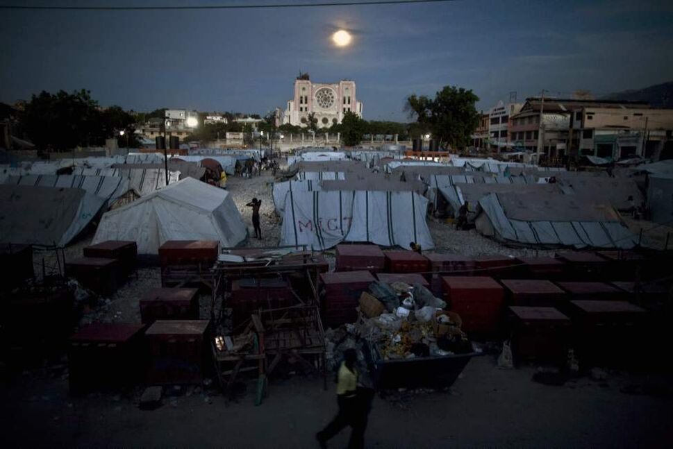 A man walks at a refugee camp, set up for people displaced by the Jan. 12 earthquake, in Port-au-Prince, Haiti, Monday, Aug. 23, 2010.  (Ramon Espinosa / The Associated Press)