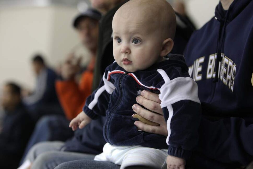 Eight-month-old Evan Graumann was one of the younger fans that couldn't keep his eyes off the Jets. (RUTH BONNEVILLE / WINNIPEG FREE PRESS)