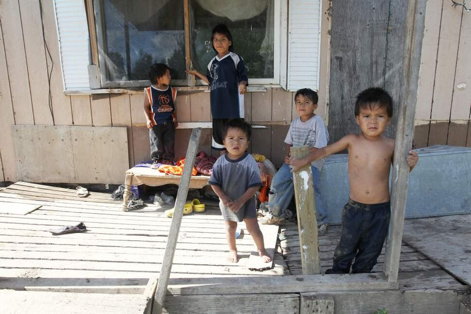 Wasagamack First Nation- Richard Andrews' grandchildren run in and outside their rundown trailer. Up to 13 people are crammed into the home without running water.     (JOE BRYKSA / WINNIPEG FREE PRESS)