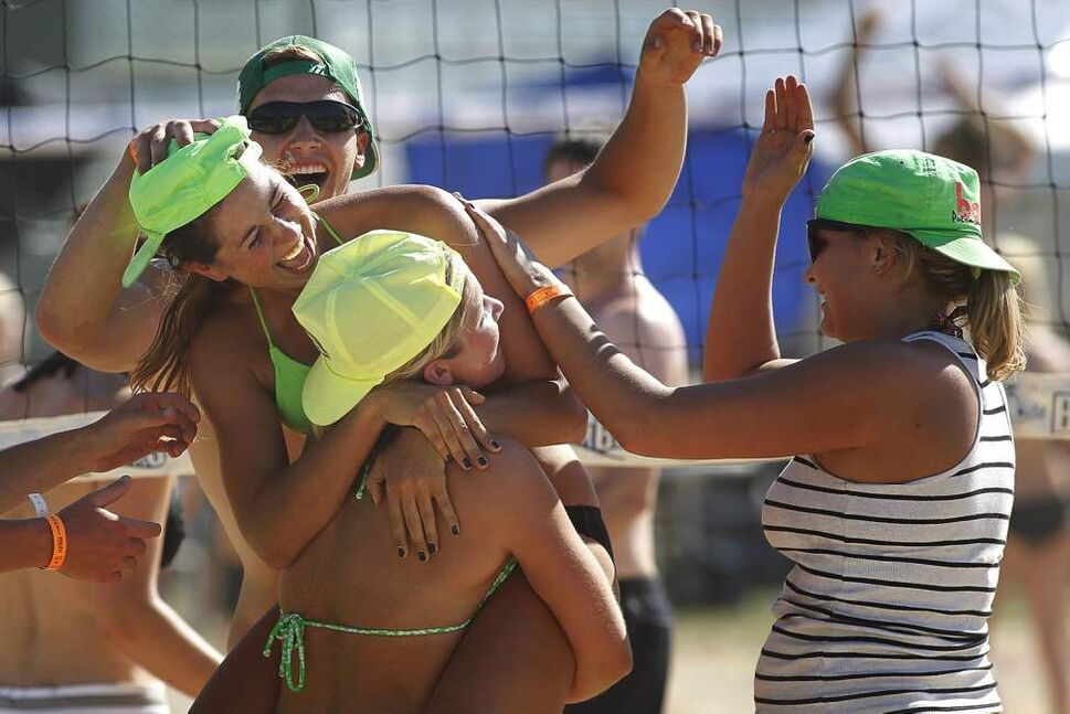 Chloe Reimer and her team Gang Green celebrate her point at the MTS Superspike beach volleyball tournament at Maple Grove Rugby Park. July 16, 2011 (John Woods/Winnipeg Free Press)