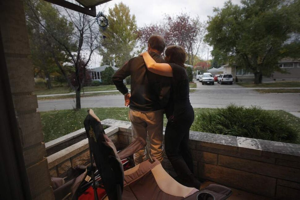 An anxious Len Mackie, heart transplant recipient, and his wife Kelly await the arrival of the parents, Joann and Roger Larre, of his donor Kyle Larre to his home in Winnipeg. October 8, 2011 (JOHN WOODS)
