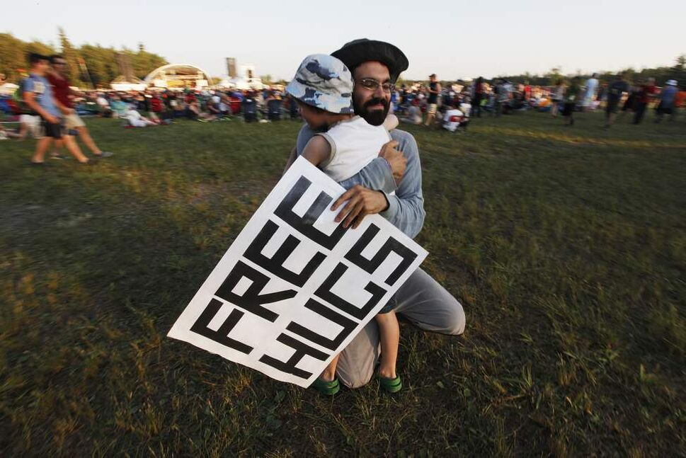 One Man gives out hugs at the Folk Fest at Birds Hill Park. July 7, 2011 (JOHN WOODS)