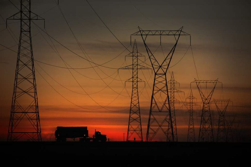 A truck passes some power transmission lines  in a sunset on the northwest perimeter. September 22, 2011 (John Woods/Winnipeg Free Press)