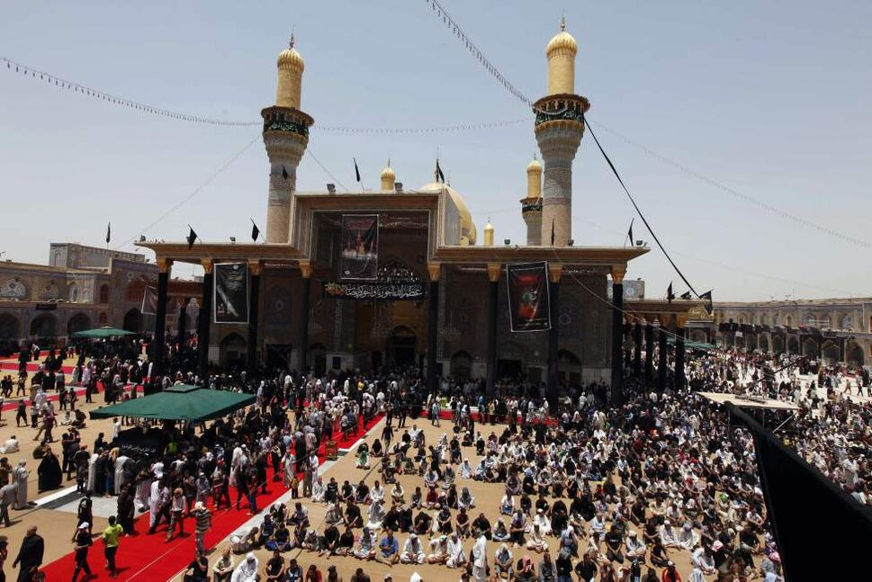 Shiite pilgrims gather at the Imam Moussa al-Kadhim shrine during the annual commemoration of the saint's death in the Shiite district of Kazimiyah, in Baghdad, Iraq, Friday, June 15, 2012.  (Karim Kadim / The Associated Press)