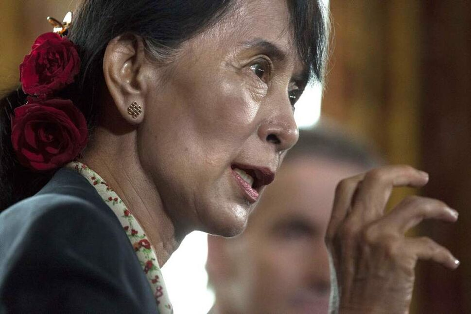 Myanmar's opposition leader Aung San Suu Kyi speaks during a news conference after attending a meeting of the Oslo Forum at the Losby Gods resort, east of Oslo. The Oslo Forum is an international network of armed conflict mediation practitioners. (AP Photo/Markus Schreiber)