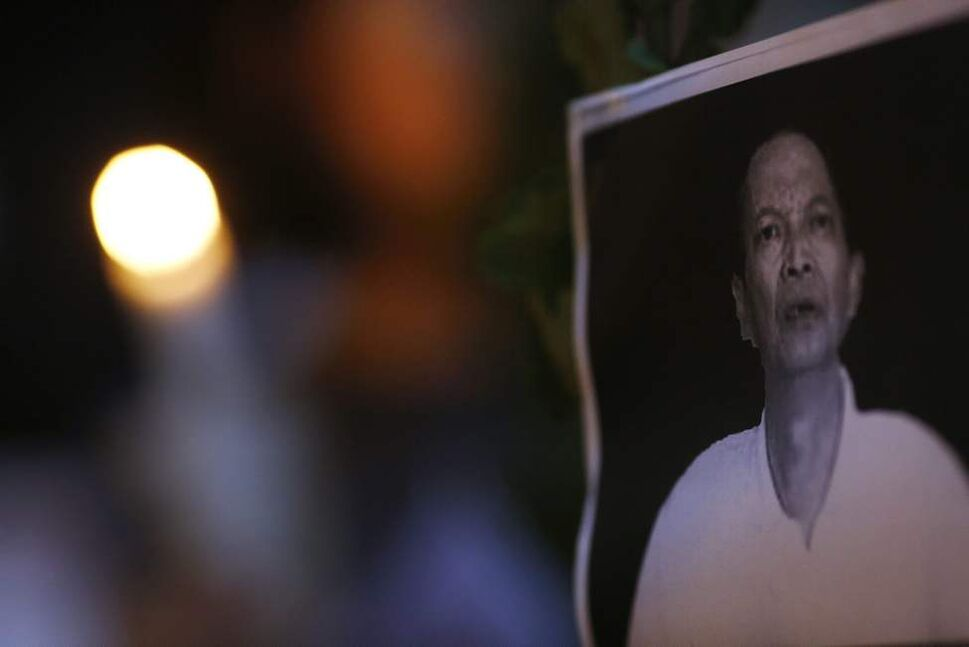 A picture of Chinese labor activist Li Wangyang is posted at a candlelight vigil to mourn Li's death in Hong Kong Wednesday, June 13, 2012. Li, imprisoned for two decades, died in a hospital Wednesday, June 6, 2012, one year after being released from jail, and a relative raised doubt on the official explanation that he had hanged himself. Li had advocated for independent labor unions in central China's Hunan province and was caught in the sweeping nationwide crackdown on all forms of dissent after the Tiananmen Square democracy protests were quashed in 1989.  (Vincent Yu / The Associated Press)