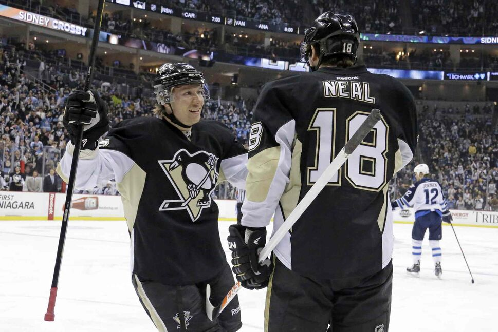 Penguins forward James Neal celebrates with teammate Jussi Jokinen after scoring his second goal of the second period. (GENE J. PUSKAR / THE ASSOCIATED PRESS)