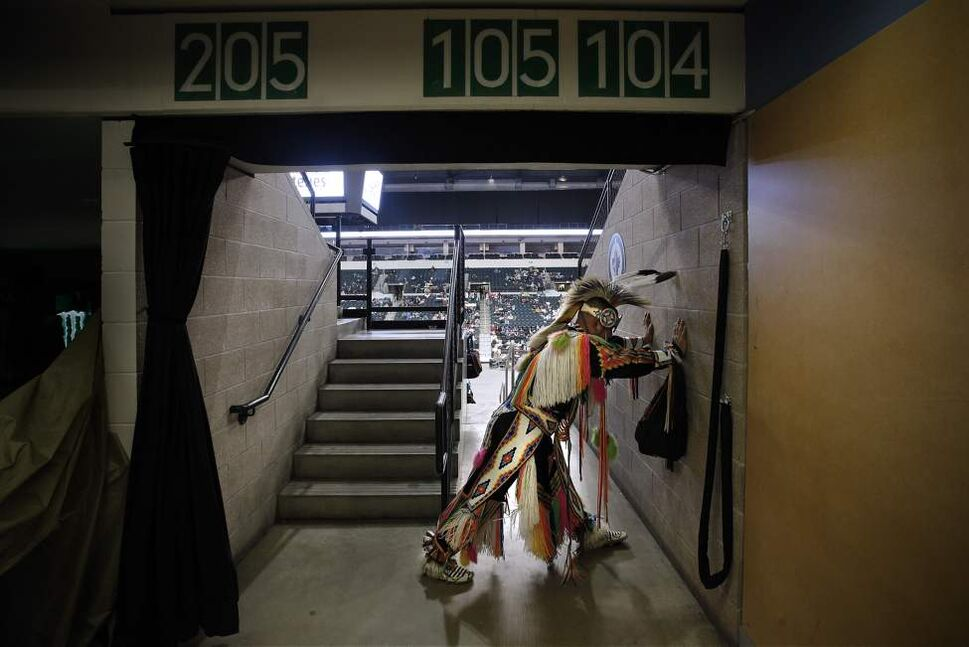 Gene Cardinal stretches prior to performing in the Men's Grass Dance at Manito Ahbee at the MTS Centre Sunday November 4, 2012.  (John Woods / Winnipeg Free Press)