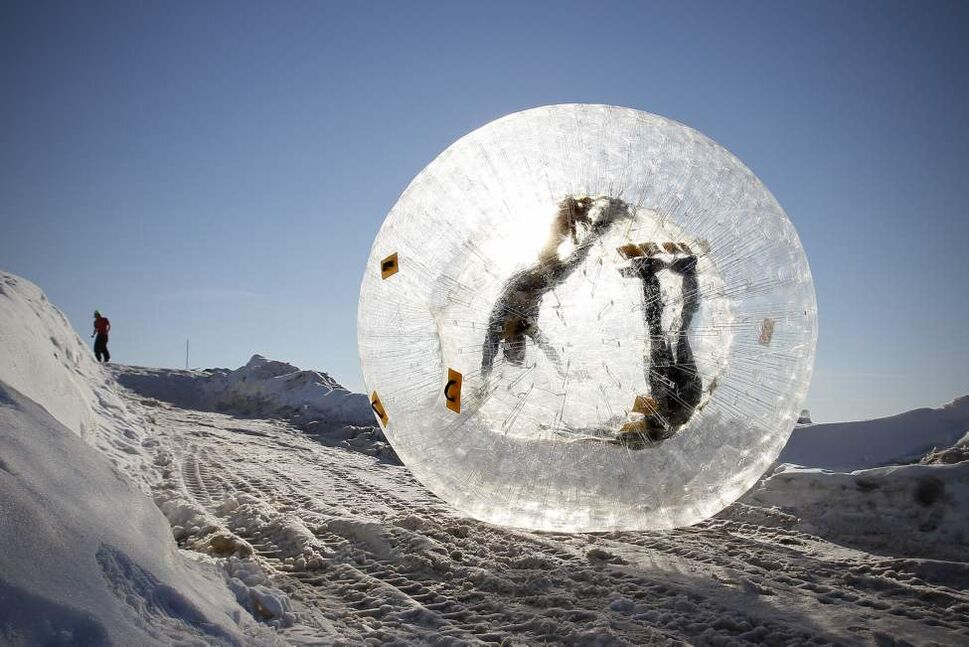 Charlenn Skead and Adam Wowchuck roll down a hill in a Zorb at Adrenaline Adventures Sunday, February 5, 2012.  This was one of Skead's birthday presents from Wowchuck. (John Woods / Winnipeg Free Press)