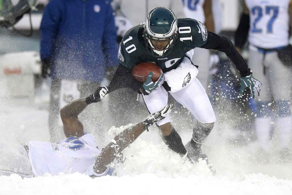 Philadelphia Eagles' DeSean Jackson (top) is tackled by Jeremy Ross of the Detroit Lions during the second half. (Michael Perez / The Associated Press)