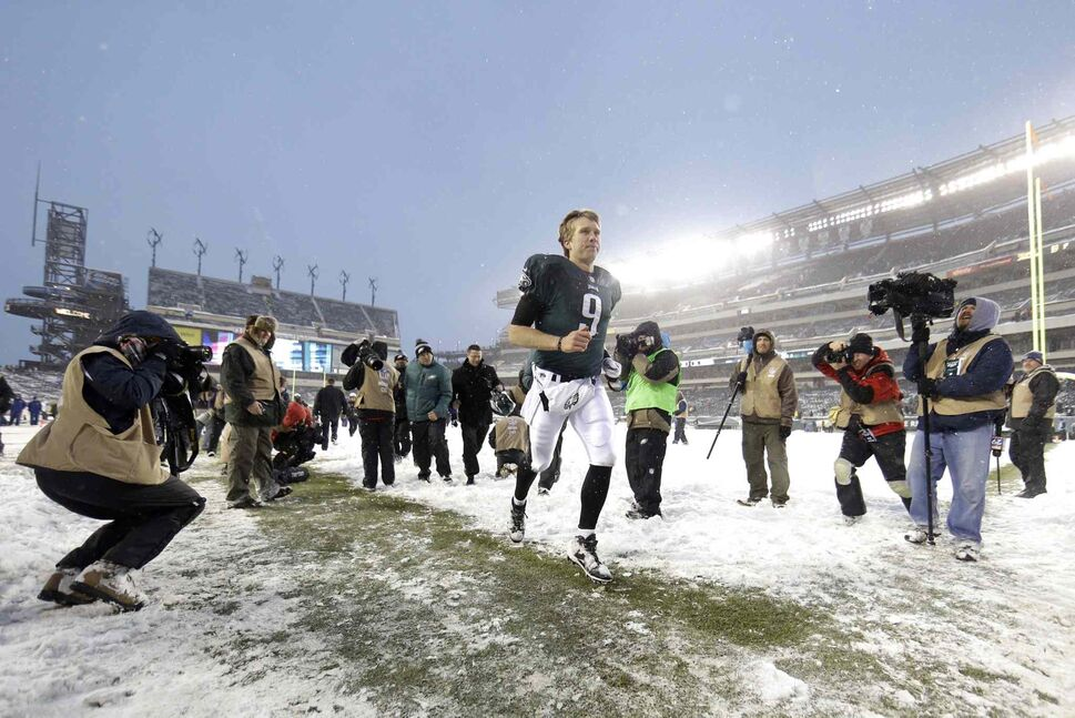 Philadelphia Eagles' Nick Foles runs off the field at the end of an NFL football game against the Detroit Lions on Sunday in Philadelphia. The Eagles won 34-20. (Matt Rourke / The Associated Press)