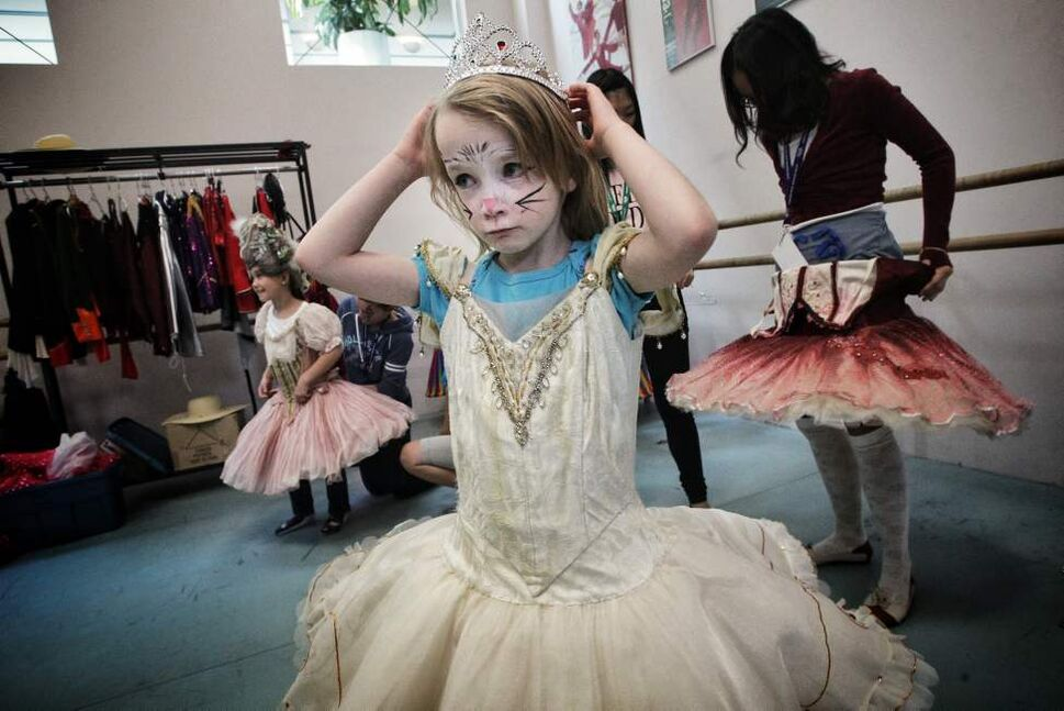 Catherine Presant, 5, puts on one of the costumes at the RWB Dance Downtown event.   Sunday, September 30, 2012.  (MIKE DEAL / WINNIPEG FREE PRESS)
