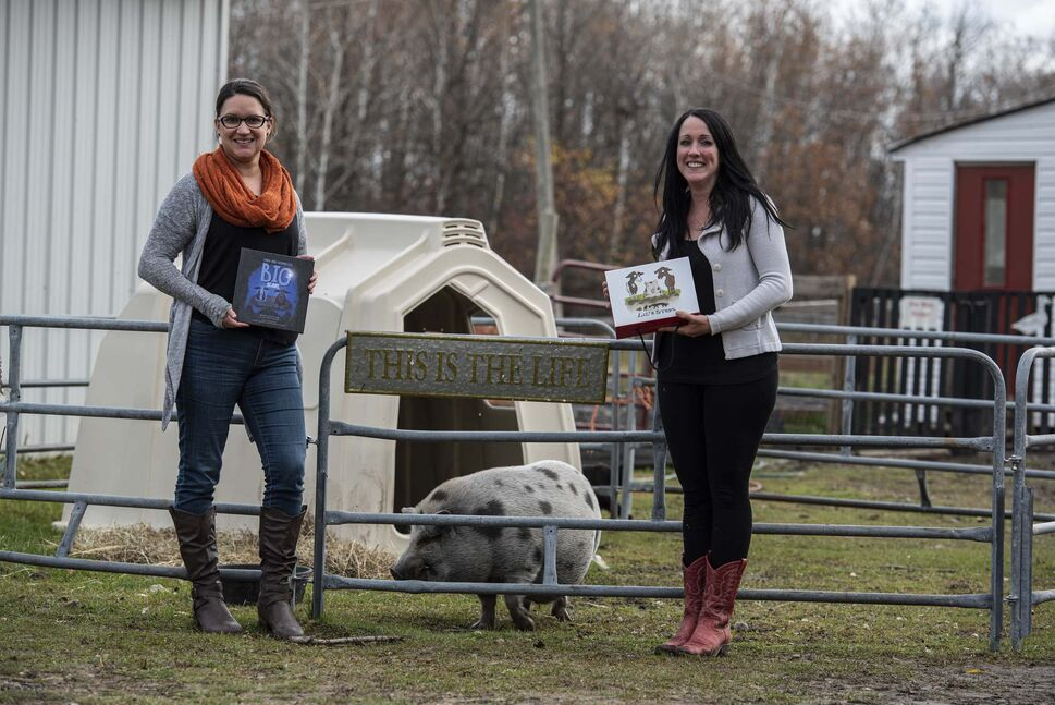 Lucy Sloan (right) and her colleague Joanne Lariviere pose with Wilbert the pig, a resident of Lil' Steps Miniature and Wellness Farm and a character in Sloan's children's book Cindy and Christabelle's Big Scare. (SUPPLIED PHOTOS</p>)