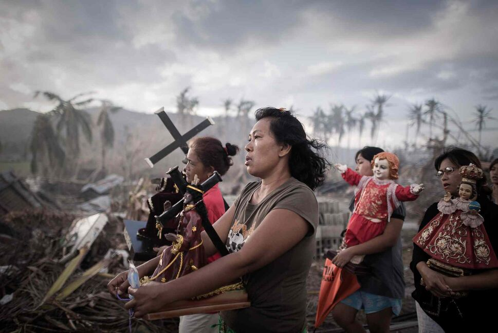 First prize in the Spot News Single category by Phillipe Lopez of France<p>  Survivors of typhoon Haiyan march during a religious procession in Tolosa, on the eastern island of Leyte, Philippines, Nov. 18, 2013. One of the strongest cyclones ever recorded, Haiyan left 8,000 people dead and missing and more than four million homeless after it hit the central Philippines.  (Phillipe Lopez, Agence France-Presse)