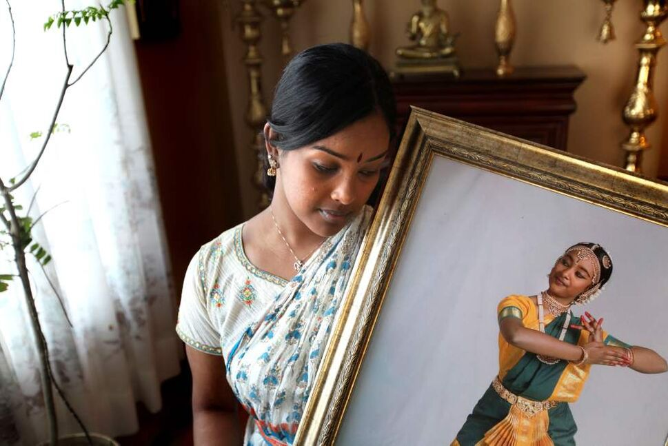 Anita Subramaniam holds a portrait of her younger sister Amutha in a traditional southern India dance pose at her home in south St Vital. Her family has started a dance scholarship in honour of  Amutha, who was recently killed in a car accident involving drinking and driving.  
