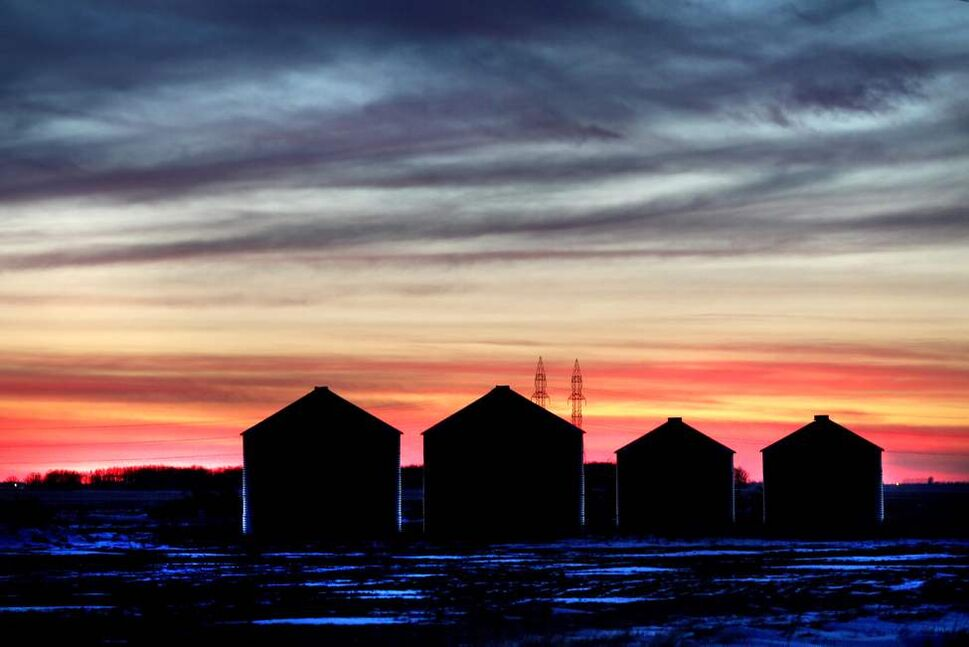 The sun sets early this time of year - around 5pm silhouetting a row of granaries in the south western skies just West of Winnipeg. 