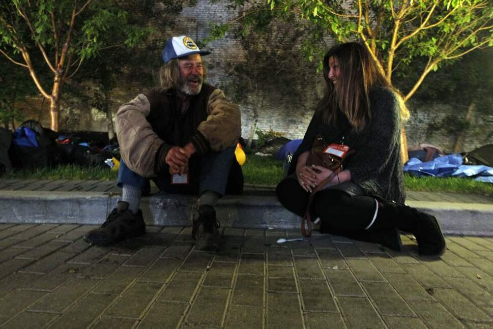 Rob shares a smile with Lisa Webinger from Recon Controls. Lisa is participating in the sleep-out corporate challenge at Portage and Main.  September 18, 2014
