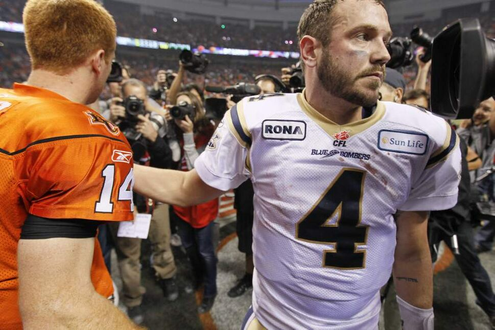 Winnipeg Blue Bombers' Buck Pierce congratulates B.C. Lions' Travis Lulay on the Lions win of the 2011 Grey Cup Sunday in Vancouver November 27, 2011.   (John Woods / Winnipeg Free Press)
