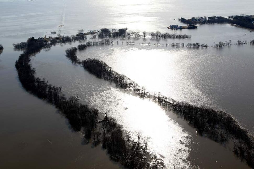 The Red River has spilled its banks near the town of St Jean Baptiste and Morris Wednesday. Local area farmers now have to travel to and from their rural properties by boat. JOE BRYKSA/WINNIPEG FREE PRESS